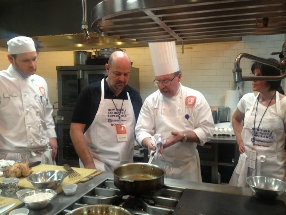 Chef Alain DeCoster taking sauces with participants